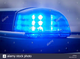 blue light on car flashing blue light on the roof of a police car stock photo