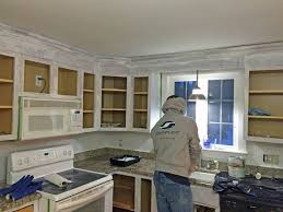 decorators white painted kitchen cabinets how to paint your kitchen cabinets before after