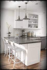 kitchen breakfast bar island white cabinets gray counters wood floors breakfast bar island don t