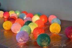 mixed colour cotton balls hanging lights patio wedding