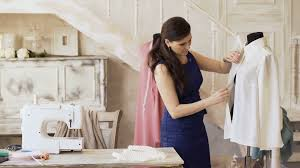 young clothing designer and seamstress check shirt in tailor