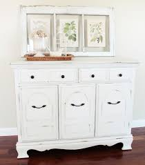 behind the red barn door white distressed buffet