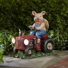 pig on tractors outdoor living outdoor decor lawn ornaments
