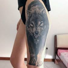 black ink wolf on left side thigh