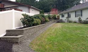 tiered retaining wall with vinyl fencing in west olympia ajb