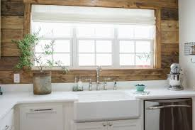 shiplap kitchen backsplash with cabinets light and bright kitchen with farmhouse sink and shiplap