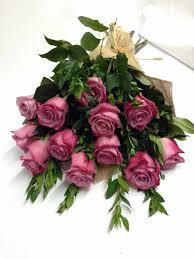 a dozen roses a dozen roses wrapped in burlap