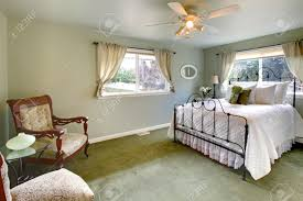 Iron Frame Beds by Olive Tones Bedroom With Antique Iron Frame Bed Green Carpet