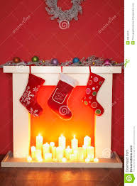 christmas stockings hanging over fireplace royalty free stock