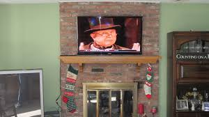 furniture beautifull mounted tv above bricks fireplace combined
