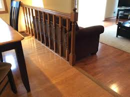 Sliding Down A Banister What To Do With Railing And Step Down Into Family Room