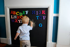 oh apostrophe nursery fireplace turned magnetic chalkboard