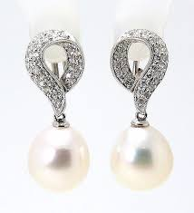 clip on pearl earrings 11 3x12 5mm white south sea pearl diamond omega clip earrings 18k whi