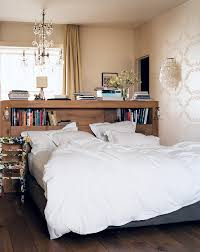 bedrooms chic bedroom with white bed and wood bookshelves bedrooms chic bedroom with white bed and wood bookshelves headboard under glass chandelier chic bedroom