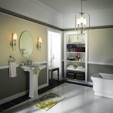 classic twin single bathroom wall lighting beside an oval mirror