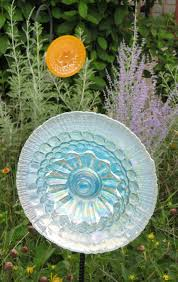 light blue and golden orange glass garden ornaments glimmering