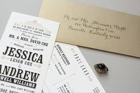 and gold typographic wedding invitations by megan wright design co