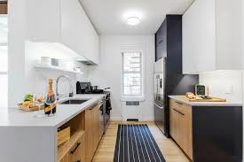 how to make a small galley kitchen work here s how to make a galley kitchen bigger sweeten