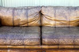 Distressed Leather Sofa by Monumental Distressed Leather And Carved Wood Sofa At 1stdibs