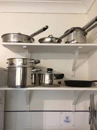 kitchen cabinet storage solutions diy pot and pan pullout organizing kitchen pots and pans pot lids