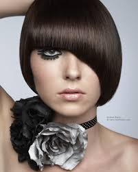 what is a convex hair cut short and sculpted fashion hairstyle hiding a part of the face