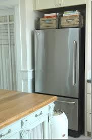 top of fridge storage baskets or bins above fridge for cookbook storage storage and