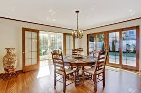 bright dining room in luxury house with french door to walkout
