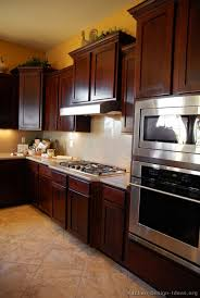 Staggered Cabinets Pictures Of Kitchens Traditional Dark Wood Kitchens Cherry Color