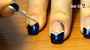 black triangular french tip with blue glitter nail design