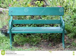 green chair or bench on ground in public park and nobody stock