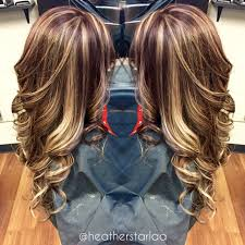 brunette hairstyle with lots of hilights for over 50 all over blonde highlight with a brown red base hair by heather