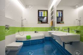 travertine house green blue and white colors in bathroom stock