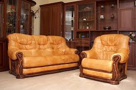 yellow leather sofa and armchair on a parquet stock photo