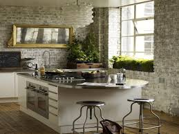 kitchen style stainless steel countertop and gray stone wall