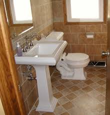 Marble Bathroom Ideas by White Single Pedestal Sink On Brown Mosaic Marble Bathroom Floor