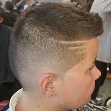 boys haircut with designs classic mohawk type burstie fade with three lines and a razor