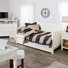 bedroom furniture white wood day with dark gray sheet and pillow