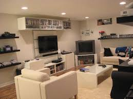 very clean gaming room with a lot of systems and consoles via