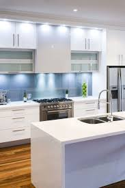 lights under cabinets kitchen appliances light brown natural tone laminated wooden floor with