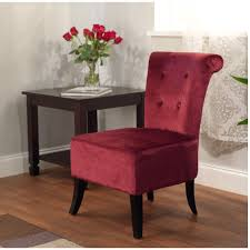 red velvet armless accent chair with high back and dark brown
