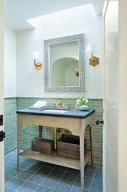 powder room with skylight and green wall tiles transitional