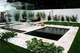 small modern garden with concrete planters elegant and airy
