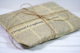 newspaper wrapping paper iron newspapers to give them an aged look then use as wrapping