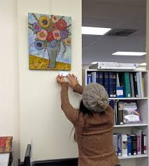 hanging artwork at the canby library blenda studio