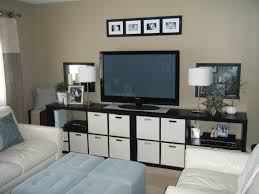 Led Tv Table Decorations Mounted Led Tv Which Combined With Black Stained Maple Wood Modern