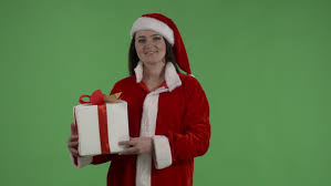 christmas holding shopping bags and wearing a santa hat gift