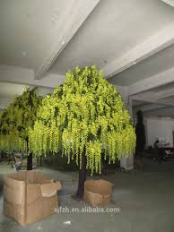 large wedding table tree centerpieces at indoor decoration yellow