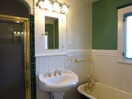 tara april glatzel the sister team info for the bathroom with tile floor wainscoting newer pedestal sink and commode with separate shower