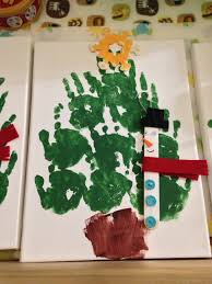 christmas 2012 handprint christmas trees on canvas boards and