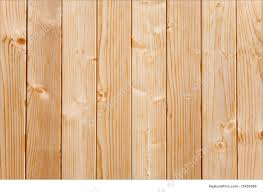 wood pannel texture closeup of panels in a pine wood fence stock picture